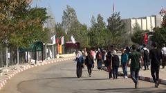 Palestinian students walk across university campus in Ramallah Stock Footage