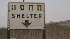 Shelter sign (in English and Hebrew) on the Golan Heights in Israel Stock Footage