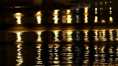 Black and White Waters in a City Pond Giving Yellow Column Reflections With a Stock Footage