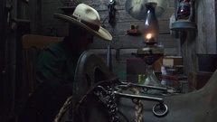 Cowboy Western, using gas lamp in bunkhouse Stock Footage