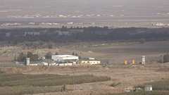 Fences and watchtowers at the Israel - Syria border Stock Footage