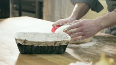 Close-up of female chef hands kneading the dough on the board. Bread preparation Stock Footage