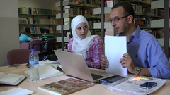 Young Palestinian professors prepare for class in library University in Ramallah Stock Footage