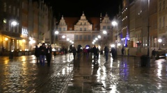 An Old Polish Palace Being Well Illuminated and People Walking Along a Stock Footage