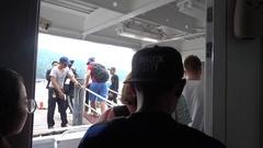 People boarding a ferry Stock Footage