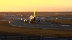 An airplane is taxiing on runway at dusk Stock Footage