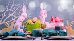 Happy Easter table setting with pink bunny and Easter Eggs centerpiece Stock Footage