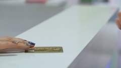 Woman makes a purchase with a gold credit card in a store Stock Footage