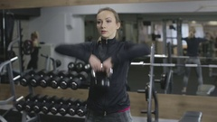 Young Woman Working Out At The Gym, kettlebell upright row Stock Footage