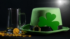St Patricks Day pouring green beer with green leprechaun hat Stock Footage