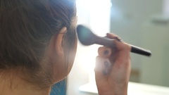 Master making make-up of a young girl in a beauty salon Stock Footage