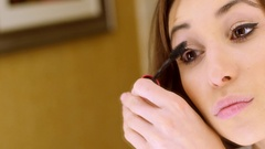 Mascara being applied on eyes - close up Stock Footage