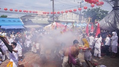 People with Firecrackers at Phuket Vegetarian Festival. Slow Motion. Stock Footage