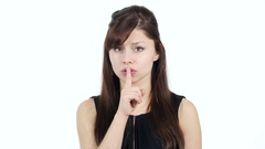 Gesture of Silence by Young Girl, Finger on Lips Stock Footage