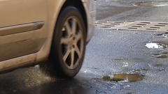 Two Cars Moving on a Rainy Road and Causing Funny Road Wave Form Tiny Spatters Stock Footage