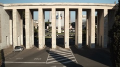 Italy eur. Fascist architecture, colonnade. Obelisk is visible beyond Stock Footage