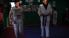 962 Slow motion video of an adult taekwondo training session in the gym, wa.. Stock Footage