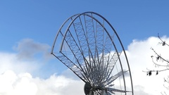 A Funny Hemispheric Framework Construction With a Flying Bird and Blue Sky Stock Footage