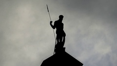 Zeus Looking Statue Standing on a Roof of a Medieval European City in Twilight Stock Footage