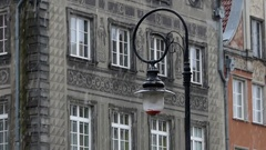 An Old Fashioned Lamppost Standing Before a Grey Old Classic Building With Xix Stock Footage