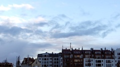 Grey and White Clouds Movibg Over European Multi Storey Buildings in Autumn in Stock Footage