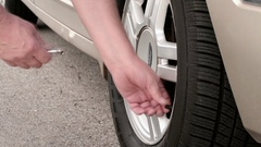 Checking Tire Air Pressure Stock Footage