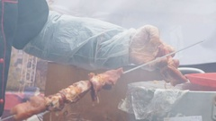 Human's hand strung pieces of raw meat on a skewer Stock Footage