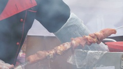 Male hand stringing pieces of raw meat on skewer Stock Footage