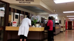 Motion of people at medical imaging reception area inside Eagle Ridge hospital Stock Footage