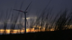 Wind Turbine at Sundown with Clouds Stock Footage