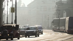 Vintage style two cars and Tram in Prague during sunset Stock Footage