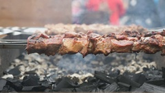 Cooking of pork shashlik on skewers on the grill Stock Footage