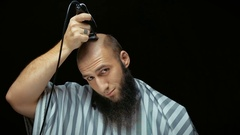 Close-up of a using clippers to shave head Stock Footage