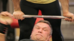 Paurlifting. The trainer insures the sports man. Gym. The man lifts heavy weight Stock Footage