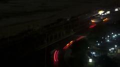 Car traffic at night through window Stock Footage