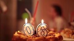 Candles numbers on the cake closeup Stock Footage