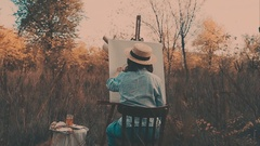 Young artist painting an autumn landscape. Girl on the nature of the artist Stock Footage