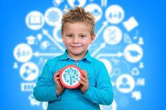 Boy is holding big clock, with animated background Stock Photos