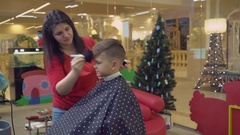 Caucasian little boy in hairdressing salon Stock Footage