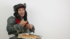 Pirate eats pizza Stock Footage