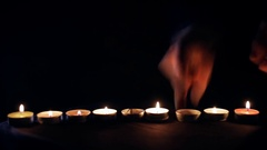 Light a lot of candles in the dark - rapid footage Stock Footage