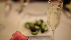 Romantic Dinner Table Setting Background with Rose and Champagne Stock Footage