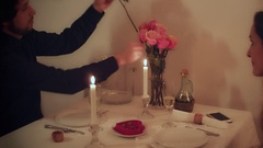 Man giving a rose flower to his date on Valentines Day Stock Footage
