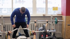 Paurlifting. The sports man. Gym. The man lifts heavy weight lying on a back Stock Footage