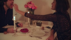 Attractive couple sharing chocolate at Romantic Valentine Day Dinner Stock Footage