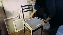 Stretching the canvas on the frame. Preparation of the canvas for drawing Stock Footage