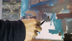 Painting with oil paints with a palette. Close-up of oil paint on the palette. Stock Footage