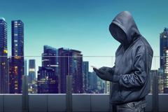 Hacker anonymous using smartphone Stock Photos