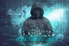 Hacker in mask typing keyboard hacking binary data Kuvituskuvat