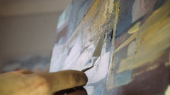 Working with a palette knife  painting with oil. Palette knife and oil painting. Stock Footage